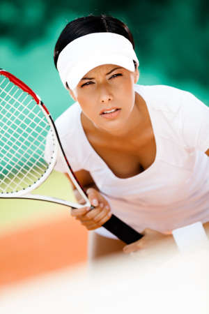 Woman in sportswear playing tennis  Pastime Stock Photo - 15647239
