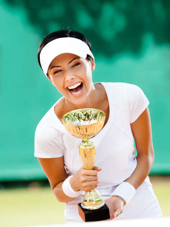 winning woman: Successful female tennis player won the cup at the sport competition  Prize Stock Photo