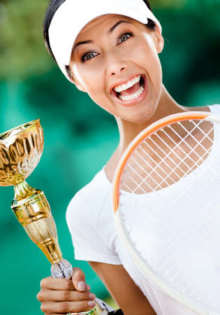 Tennis player won the cup at the sport tournament  Trophy photo