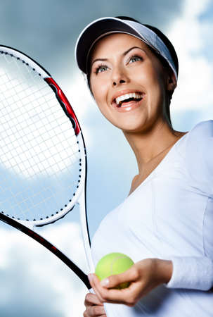 tennis racket: Close up of female tennis player with tennis racket and ball against the sky