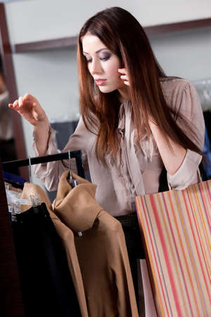 Speaking on the phone and buying clothes at the store Stock Photo - 15647299