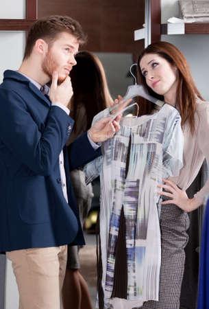 consider: Woman asks her boyfriend to present her a dress