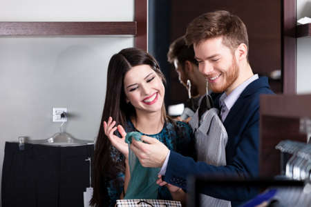 Beautiful couple looks at purchases in the shop Stock Photo - 15647288