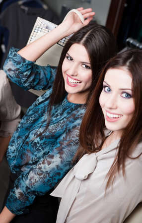 After shopping happiness of two girlfriends with long dark hair photo