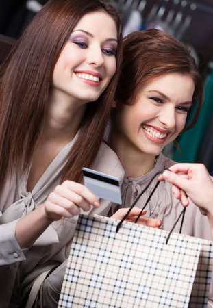 pay for: Pretty women pay for purchases with credit card Stock Photo