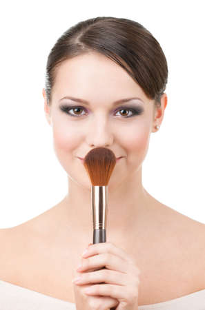 Woman with cosmetic brush for powder, isolated on white photo