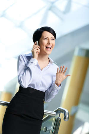 adult intercourse: Business woman in business suit talks on phone. Communication