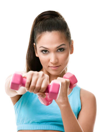 Athletic young woman works out with pink weights, isolated on white photo