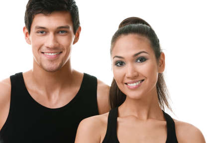 keep fit: Two sportive people in black sportswear, isolated on white