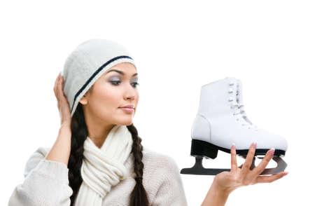 Female figure skater looks at the skate, isolated on white Stock Photo - 15719969