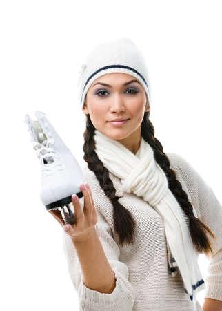 Female figure skater demonstrates one skate in hand, isolated on white Stock Photo - 15719966