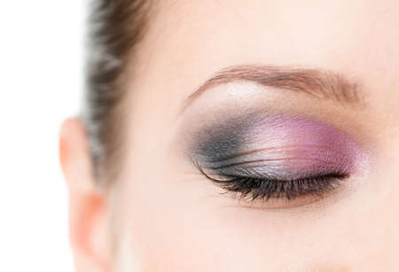 eye shade: Close up of womans closed eye with makeup of pink and grey eye shades, isolated on white