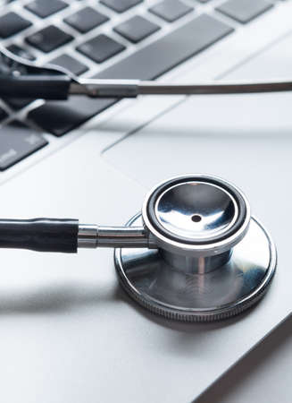 Close up of stethoscope on computer keyboard. Healthcare concept photo