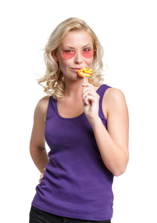 Woman in heart shaped glasses with round lollypop, isolated on white Stock Photo - 15868278