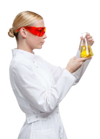 Woman doctor hands conical flask with yellow liquid, isolated on white, side view Stock Photo - 15868199
