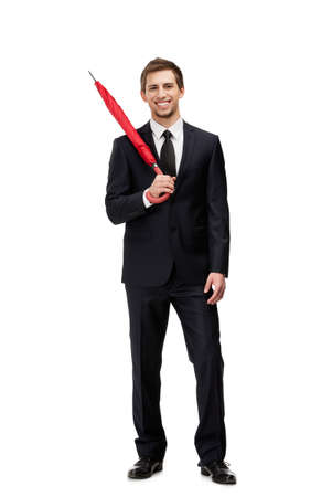Standing man with closed red umbrella, isolated on white photo