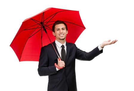 Palming up man with opened red umbrella checks the rain, isolated on white photo