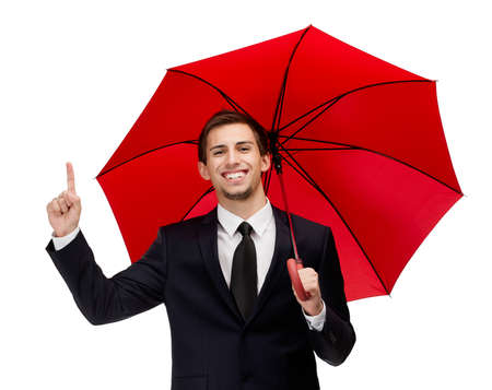 Forefinger gesturing man with opened red umbrella overhead, isolated on white photo