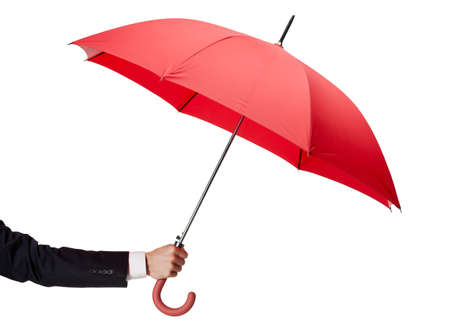 Close up of opened opened umbrella in hand, isolated on white photo