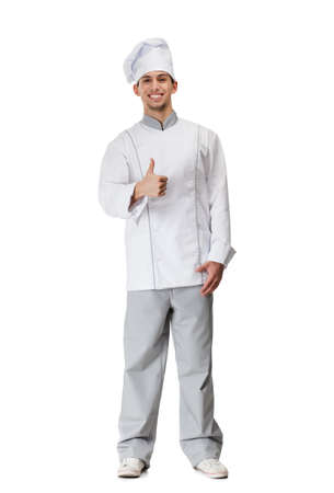 Cook in uniform thumbs up, isolated on white photo