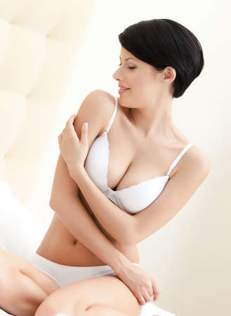 woman bra: Portrait of a halfnaked woman with crossed arms