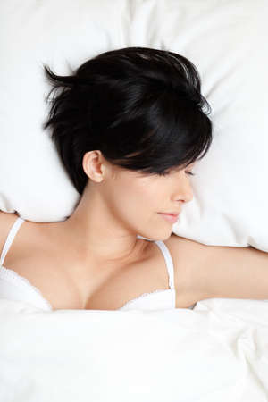 Sleeping woman in the bed with white bedclothes, white background Stock Photo - 15868261