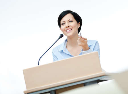 presenting: Female executive at the board. Business conference Stock Photo