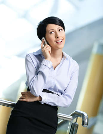 adult intercourse: Business woman in business suit talks on cellular phone. Communication