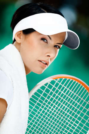 Close up of professional tennis player with towel on her shoulders Stock Photo - 15868247