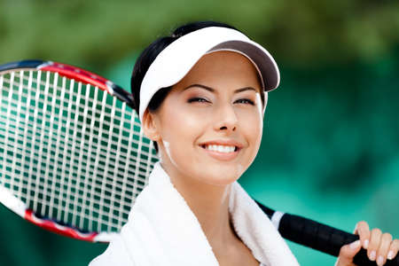 Close up of female tennis player with towel on her shoulders photo