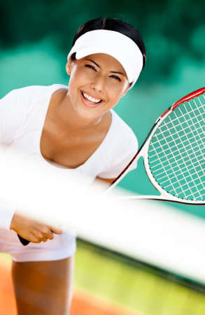Woman in sportswear playing tennis. Competition Stock Photo - 15868039
