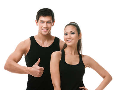 Two positive sportive people in black sportswear, isolated on white photo