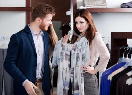 insists: Woman insists that her boyfriend to present her a new dress