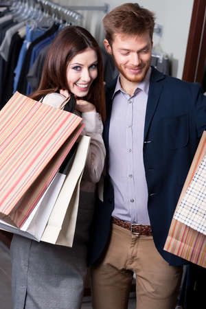 Positive couple does shopping photo
