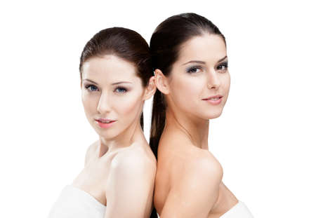 Half length portrait of two  women who are ready for beauty procedures, isolated on white photo