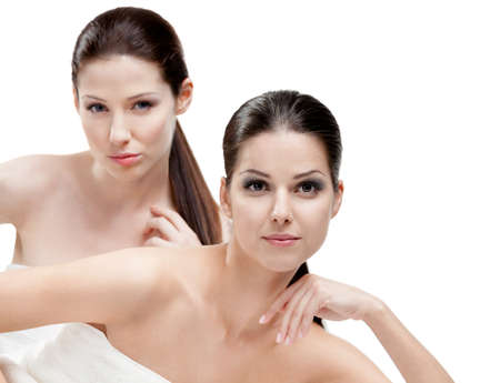 Half length portrait of two  women who are ready for beauty procedures, isolated photo