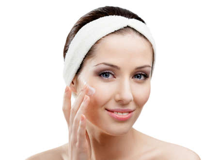 Woman with headband making face lifting procedures, isolated photo