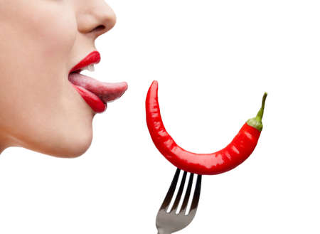 chilli: Close up of womans tongue and capsicum on stainless fork, isolated on white