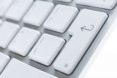 Close up view of buttons of white pc keyboard photo