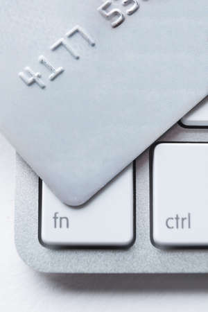 Close up of credit card on a laptop keyboard. Concept of internet shopping photo