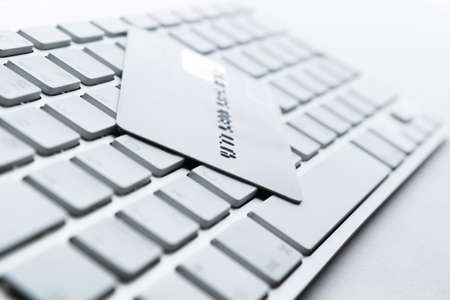 Close up of credit card on a computer keyboard. Concept of internet buying photo