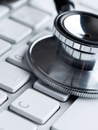 computer part: Close up of stethoscope on computer keyboard. Medicine concept