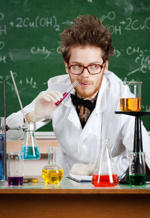 mad scientist: Mad professor tastes the pink liquid