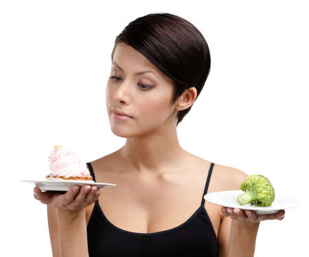 doubtfulness: Woman doubts between tasty cake and healthy broccoli, isolated on white Stock Photo