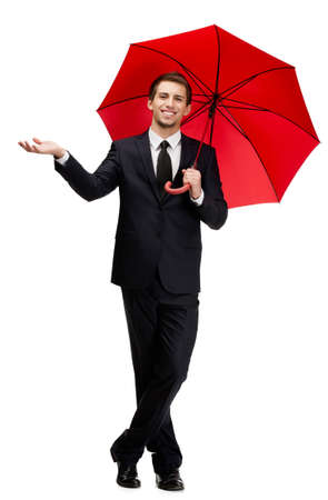 Palming up man with opened opened umbrella checks the rain, isolated on white photo