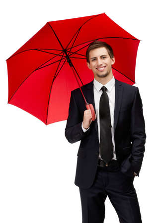 Businessman holding opened red umbrella overhead, isolated on white photo