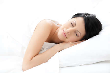 Woman sleeps in bed, white background photo
