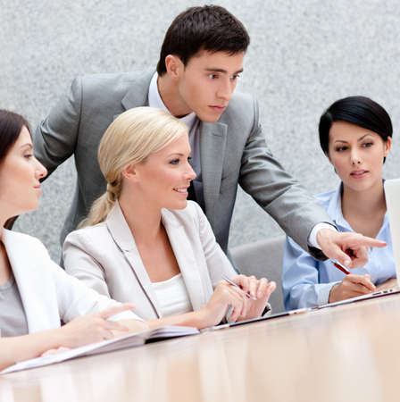 Business people discuss something at the meeting at the modern office building. Teamwork success Stock Photo