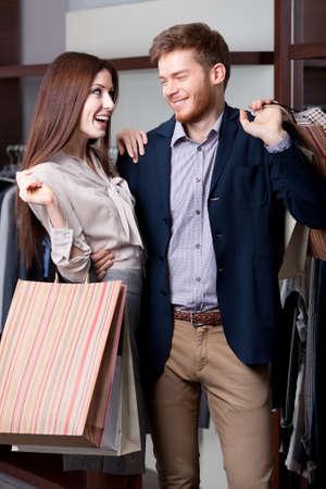 boutique shop: Smiley couple likes shopping Stock Photo