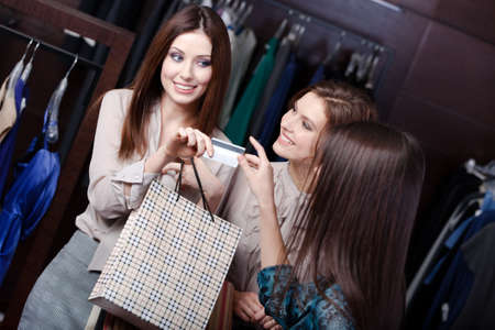 Pretty women pay with credit card and take away purchases photo